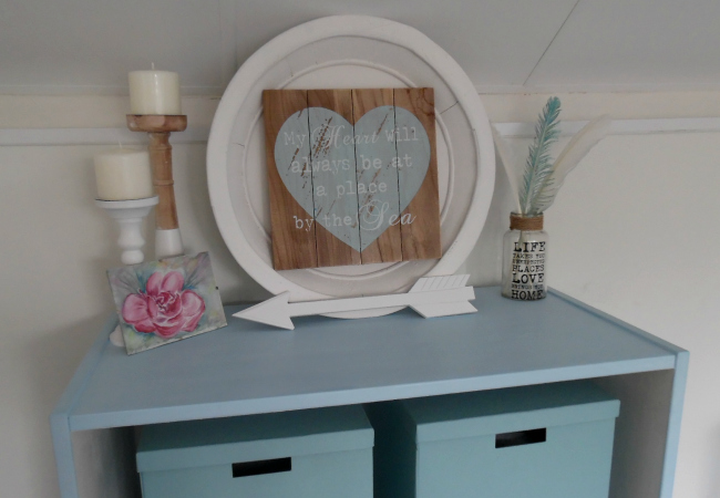 Coastal Themed Accessories On Bookcase Painted With Blue Chalk Paint