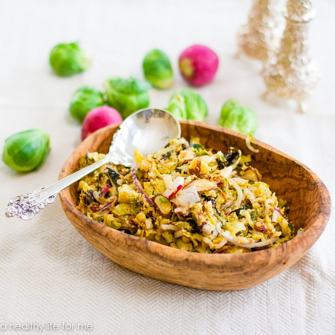 Roasted Brussels Sprouts Slaw is a multi- layered salad that has so much delicious flavor and crunch. A super healthy, gluten free recipe that is loaded with nutritious clean ingredients | ahealthylifeforme.com