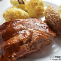 Make tender and flavorful instant pot apple barbeque ribs in under an hour with this 5 ingredient recipe. Pressure Cooker Apple BBQ Ribs recipe from aileencooks.com.