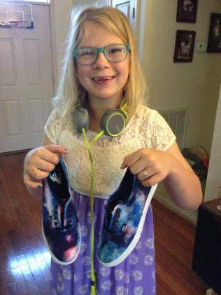 Anna Kate showing off her tie-dyed kicks. May 2, 2014