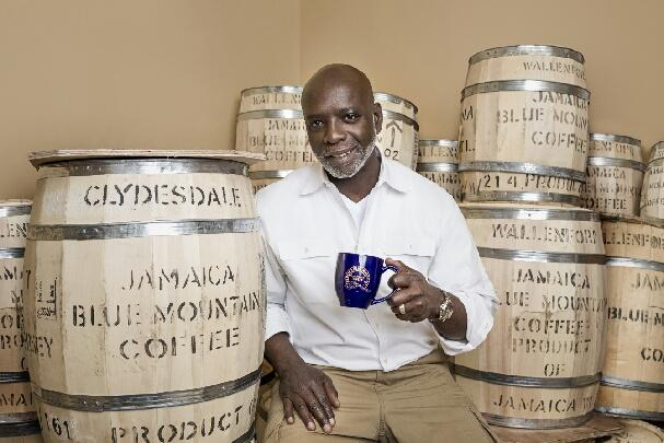 man holding a cup of jamaican blue mountain coffee cup