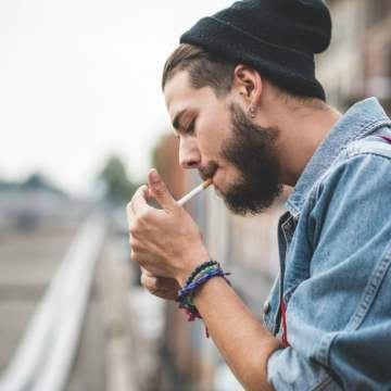 cigarettes kill: hipster man smoking