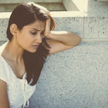 sad woman looking despondent