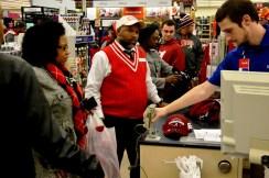 Jonathan Hollman checks out at Academy. (Solomon Crenshaw Jr./Alabama NewsCenter)
