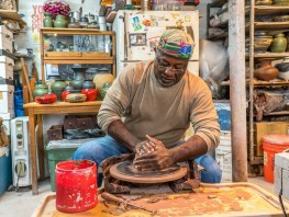 Charles Smith, at work in his Mobile studio, says pottery saved him from being consumed by the feelings he brought back from the Vietnam War. (Mark Sandlin/Alabama NewsCenter)
