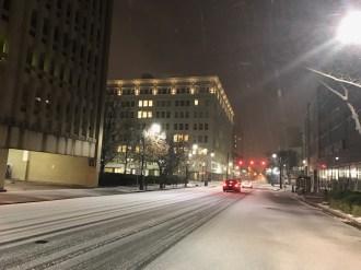 Snow covers the already quiet streets of downtown Birmingham Friday night. (Deon Gordon/Alabama NewsCenter)