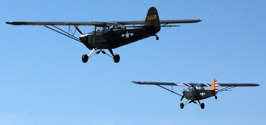 two Aeronca L3s in formation
