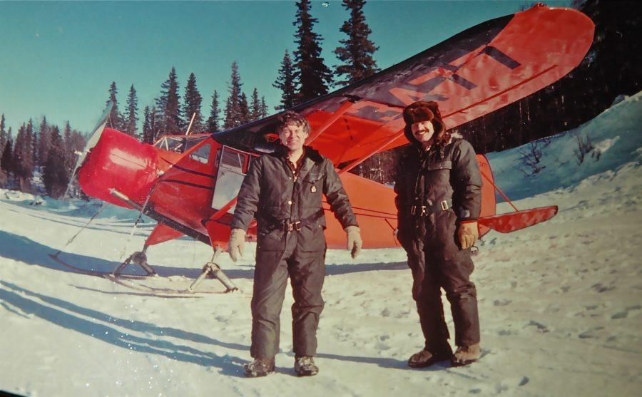 Iditarod pilots left Ace Dodson and Tony Oney in front of a historic Stinson SRJR used for flying early Iditarod Sled Dog Trail races. Photo by Bill Philbin