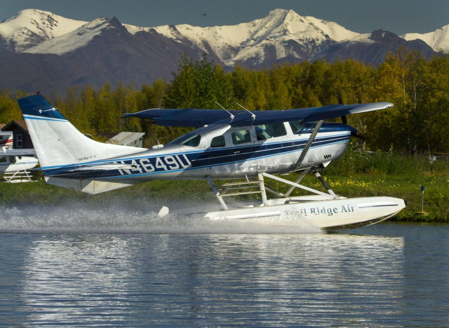 Cessna 206 on floats on a high speed taxi at PALH.
