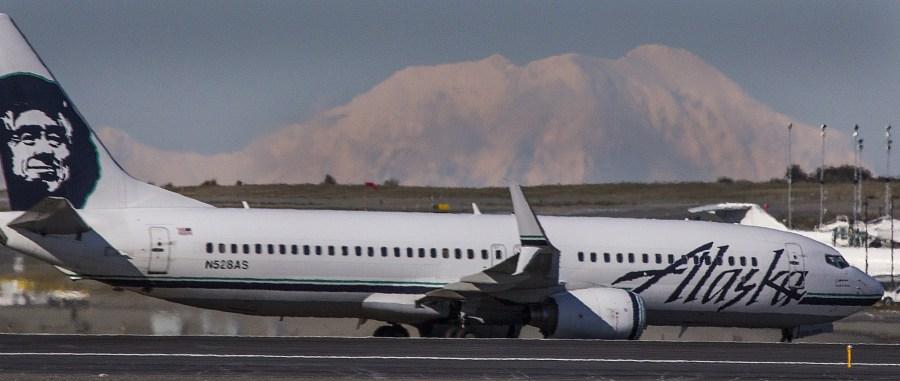 Alaska Air jet in front of Mt. Foraker at PANC. Photo by Rob Stapleton/Alaskafoto
