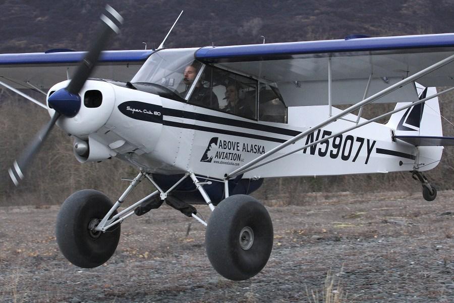 PA-18 on Tundra Tires landing on gravel