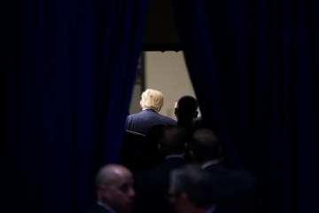 Republican presidential candidate Donald Trump departs after speaking at a rally at Muscatine High School in Muscatine, Iowa, Sunday, Jan. 24, 2016. (AP Photo/Andrew Harnik)