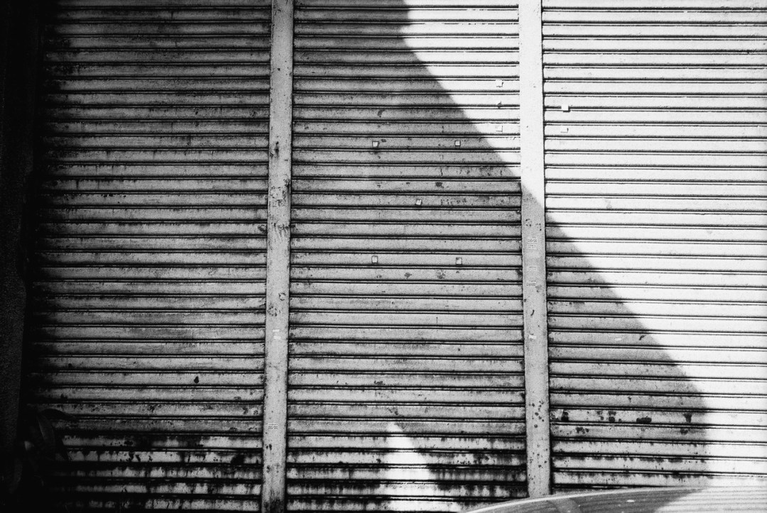 Shuttered - Shot on ILFORD FP4 PLUS at EI 125. Black and white negative film in 35mm format.