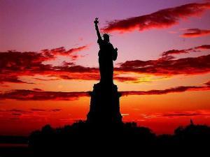 Statue of Liberty with Sunset (https://pbs.twimg.com/media/BAI_wySCcAEOgaK.jpg)