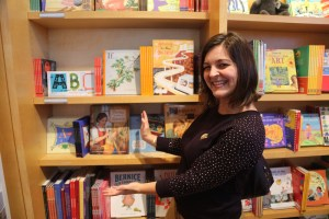 Photo of Alexandra Hinrichs with Thérèse Makes A Tapestry on the Shelf at the Getty Bookstore