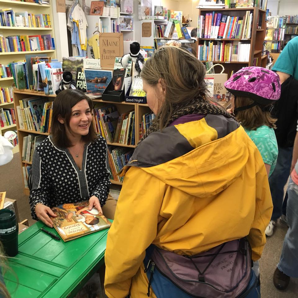 photo of Alexandra S. D. Hinrichs signing books at The Briar Patch in Bangor, ME