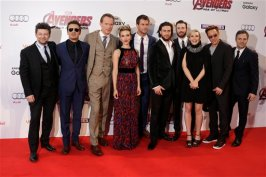From left, Andy Serkis, Jeremy Renner, Paul Bettany, Scarlett Johansson, Chris Hemsworth, Aaron Taylor-Johnson, Chris Evans, Elizabeth Olsen, Robert Downey Jr. and Mark Ruffalo pose for photographers upon arrival at the premiere for the film 'The Avengers Age of Ultron' in London, Tuesday, 21 April, 2015. (Photo by Joel Ryan/Invision/AP)