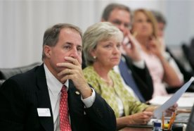 Georgia state school superintendent Brad Bryant, left, and state school board members listen to Gov. Sonny Perdue address them about his office's findings regarding state standardized test score data, Wednesday, Aug. 18, 2010 in Atlanta . (AP Photo/John Amis)