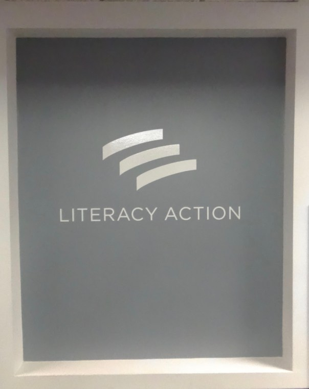 Literacy Action's logo in the atrium of the Atlanta office. Photo: Alicia Buster