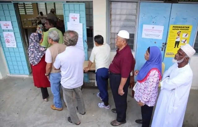 Voters turn out on polling day - Photograph: Malay Mail Online