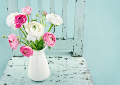White and pink flowers on light blue chair