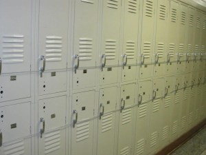 Lockers were chained closed because there weren't enough for everyone and besides, when they are open there wasn't enough room to walk down the halls.
