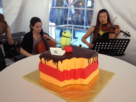 The wedding cake, surrounded by a string quartet
