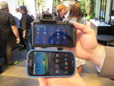 The back of the Galaxy NX camera, next to Samsung's Galaxy S III smartphone