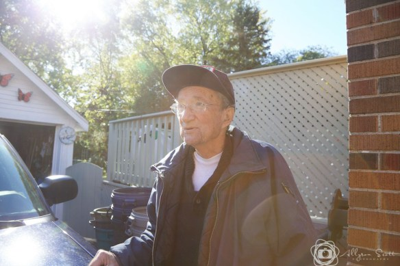 Peter talking outside his garage