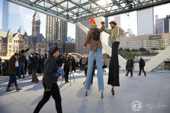 Protesters on stilts at City Hall