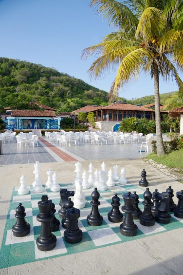 Pool area with life-sized chess pieces