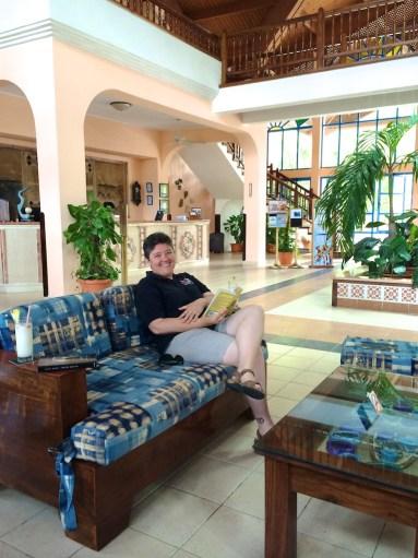 Jody reading in the lobby