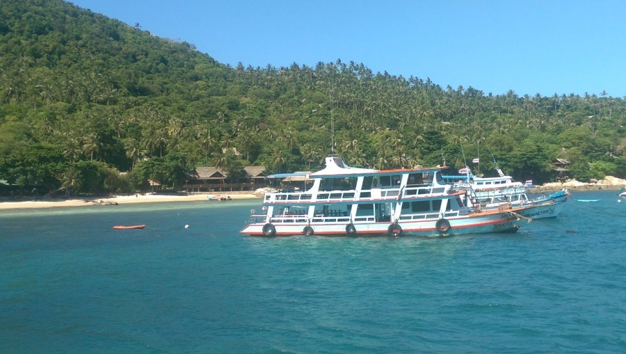 A diving boat with one of the main beachfronts in the background
