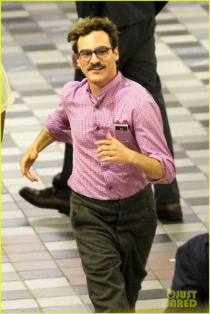 *EXCLUSIVE* A mustached Joaquin Phoenix films at a metro station