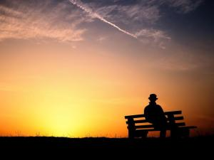 man-on-bench-sunset