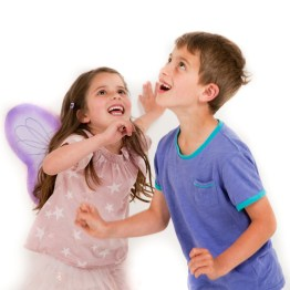 girl dressed up as a butterfly playing with his brother lots of fun