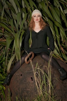 Black dress and model on a Bomb. Photo by Anais Chaine Photography Auckland, NZ, wearing Selector clothing. Fashion photoshoot in Bethells, Waitekere range