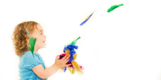 Toddler little girl playing with feathers professional studio photography by Anais Chaine in Auckland Ponsonby New Zealand