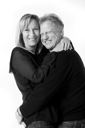 Old couple still in love and happy hugging, blond lady, studio photoshoot in Auckland, new zealand