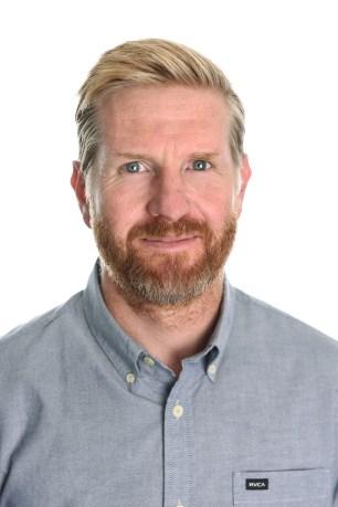Staff director portrait white studio background