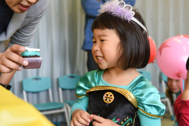 Young chinese girl with princess green dress and a crown