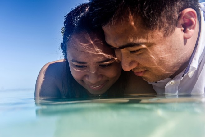 close up portrait of a couple looking at the sea