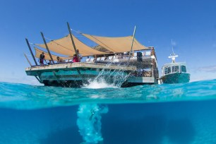 someone dived in the water at Cloud 9 in Fiji by Anais Photography