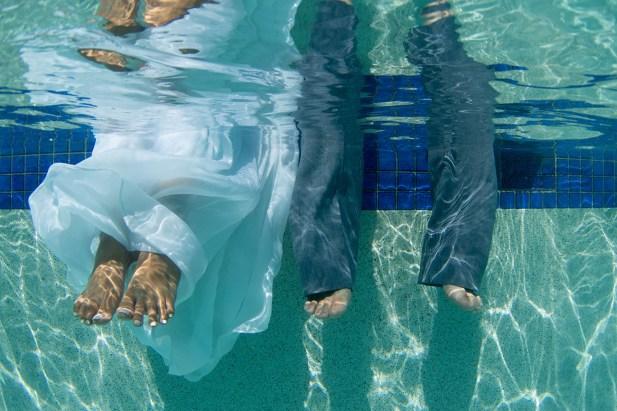 feet of a couple underwater in the swimming pool of the westin hotel in Denerau island Fiji