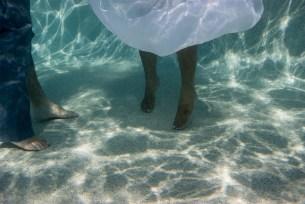 feet of the bride underwater