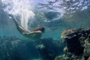 Bride swimming by coral in Fiji