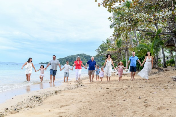 Group family stroll on the beach at Malolo Island Resort Fiji