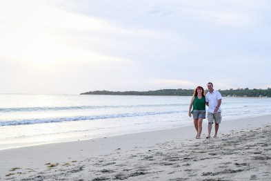 Husband and wife stroll along the beach in Fiji family photography