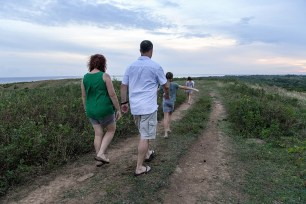 Family walks down lonely path in Natadola Fiji