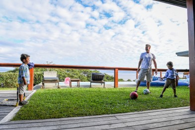 Dad stops soccer ball during Fiji family vacation